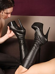 A slaveboy cleaning mistress` boots