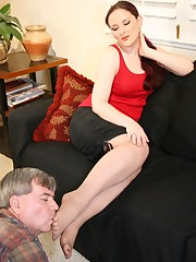 A submissive husband is licking toes