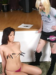 Domina torments tits of female slave