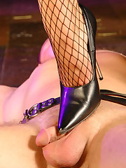 Mistress stretches a man on the floor and straps a dildo to his face to ride it dirty