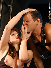 Domme suspends and lashes mature slave, ties his cock and balls and makes him worship her legs