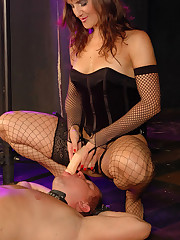 Mistress in fishnet stockings takes control face-fucking restrained male slave with a strapon