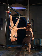 Mistress suspends restrained slave upside down and dips his head in ice cold water