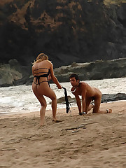 Blonde mistress rides her slave`s back and makes him eat her pussy right on the beach