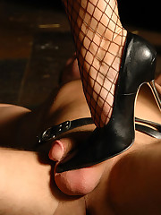 Mistress in sexy stockings steps on her slave`s cock and rides a dildo sticking out of his mouth