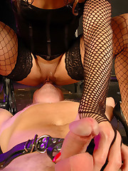 Mistress in fishnet stockings sits on her slave`s face making him lick her pussy and ass