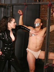 Chained stud gets a nasty whipping and spanking from a chick