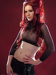 Fiery red head models for Kaoskittens for her first time.