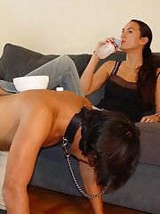 Two slaves are under mistress` feet