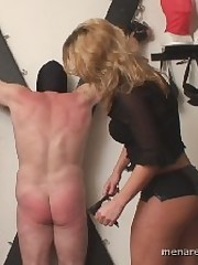 Two sexy girls were beating bounded man with whip.