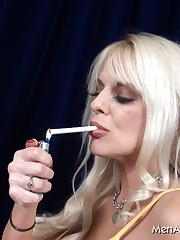 Smoking blonde makes her sub breath in cigarette smoke