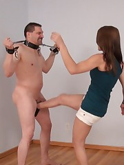 Two ladies practicing in kicking naked slave's balls