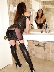 The mistress wears nylons and thigh boots