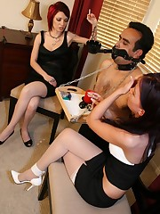 Submissive slave serviced two mistresses
