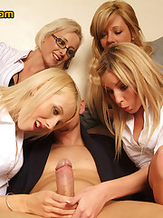 Two young girls learn from some MILFs how to play with a man's cock