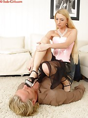 Blonde trampled and humiliated man by heels
