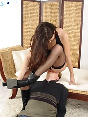 Girl in nylon sat on slave