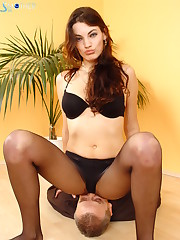 Mistress in pantyhose sat on slave