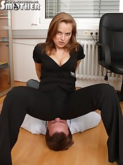 Mistress in black sat on slave