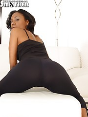 Slender ebony Mistress with hot bootie preparing for smothering action
