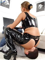Latex goddess with cut ass sat at the man's face.