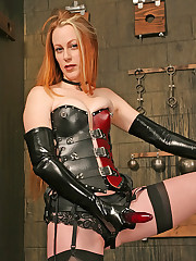 Tall strapon mistress poses in dungeon