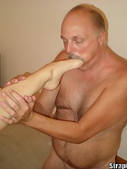 Bobbie taking All of the Strap On Princess Toes in his Mouth