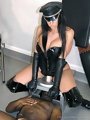 A leather mistress fucked slaveboy