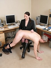 Mistress punished an office boy by the paddle