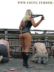 Two mistresses tormented slaves outdoor