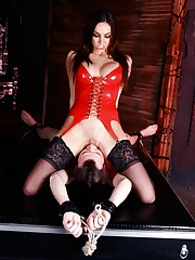 Domina Tiffany Tyler locks her slave in chastity and orders him to worship her pussy