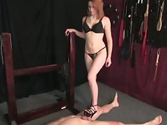 A captive gets to look at his mistress's cunt while licking her shoe