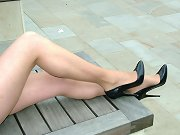 This babe loves to show off her black high heels outdoors