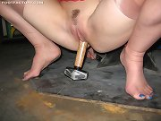 Noname Jane kicks a punching bag in her stockings and filthy stockinged feet.