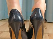 Sexy women in grey heels and a cheeky tartan dress