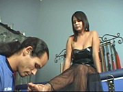 Threatening to never show her feet to her foot slave ever again unless he gets there in thirty minutes Michelle waits in some sexy fetish lingerie.