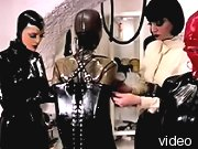 Kinky submissive completely encased in latex.