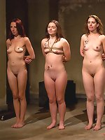 Four slavegirls undergo a fierce training session.