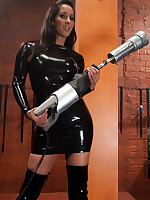 Fetish-clad domme tries her new fucking machine out on slaveboy