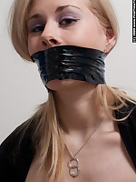Blonde bondage amateur tied in rope and gagged with tape