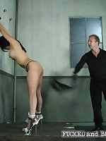 Slavegirl is stripped, suspended and forced to suck cock
