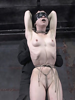 Petite submissive suspended upside-down by one ankle