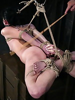 Gorgeous girl in strict rope hogtie