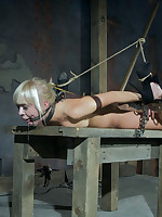 Pretty blonde gagged, bound with belts, humiliated