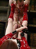 Latex-clad Domme inflicts heavy CBT.