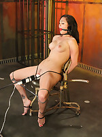 Brunette immobilized in chair bondage