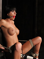 Pretty girl struggles in inescapable chair bondage