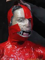 Helpless slavegirl mummified in bondage tape