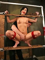 Hot brunette bound spread-eagle in red rope