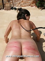 Brunette shows off beautiful striped ass after whipping